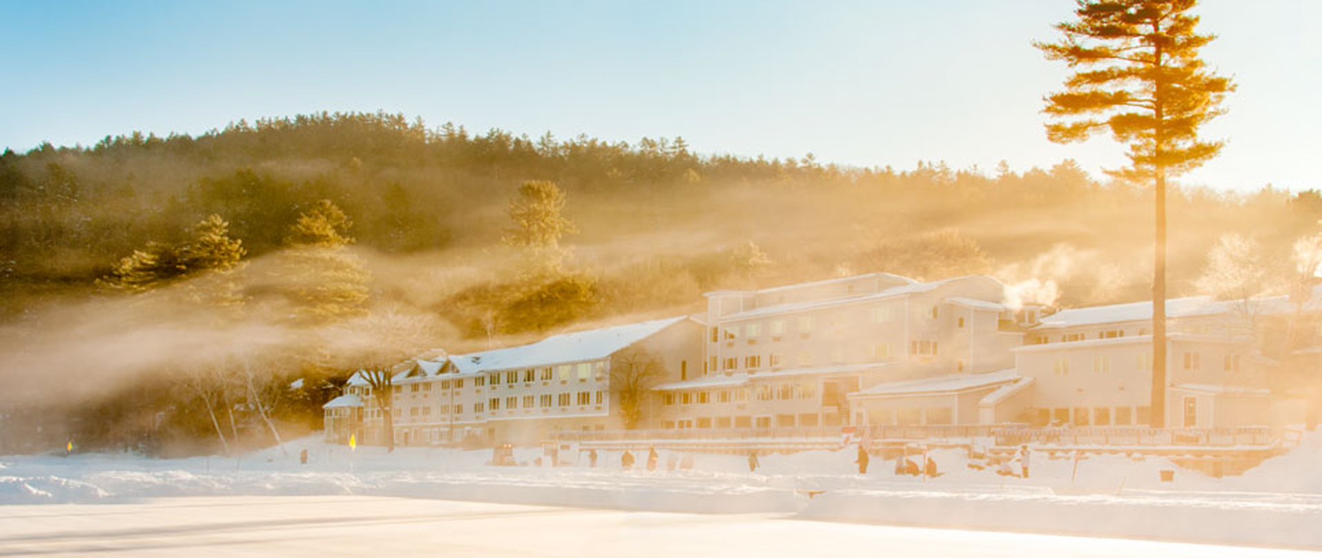 Lake Morey Resort building in the winter with morning fog and sunrise