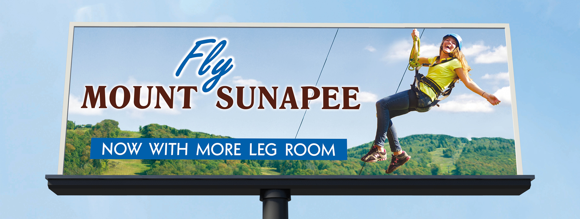 Fly Mount Sunapee billboard, now with more leg room with female on zipline