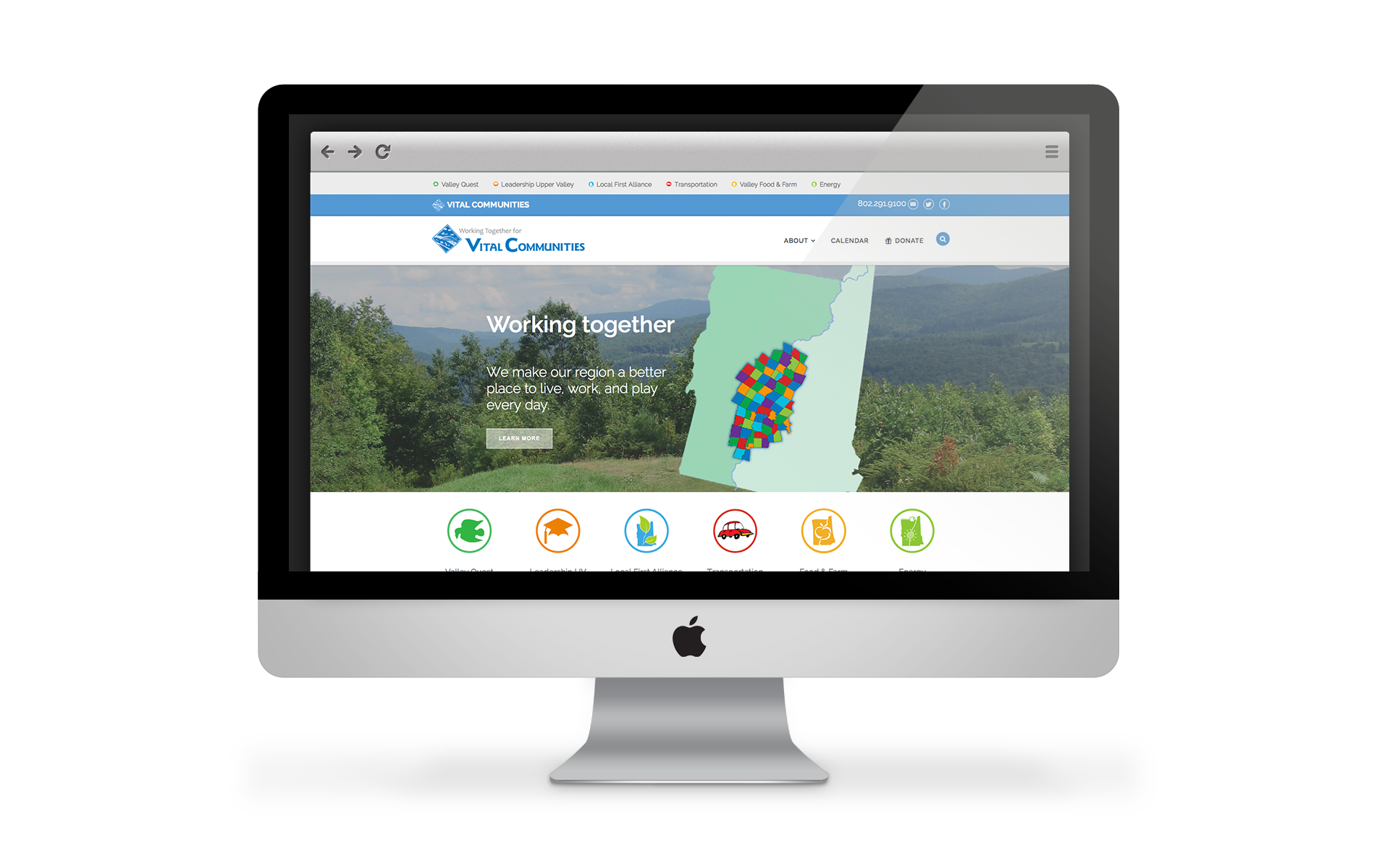 Sample image of the Vital Communities' website displayed on a iMac