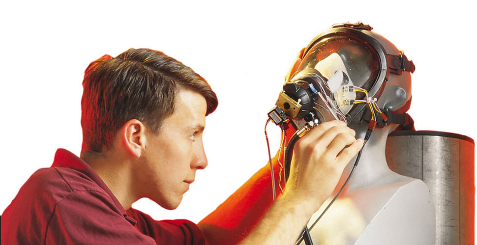male engineer working on an electronic mask for a human head